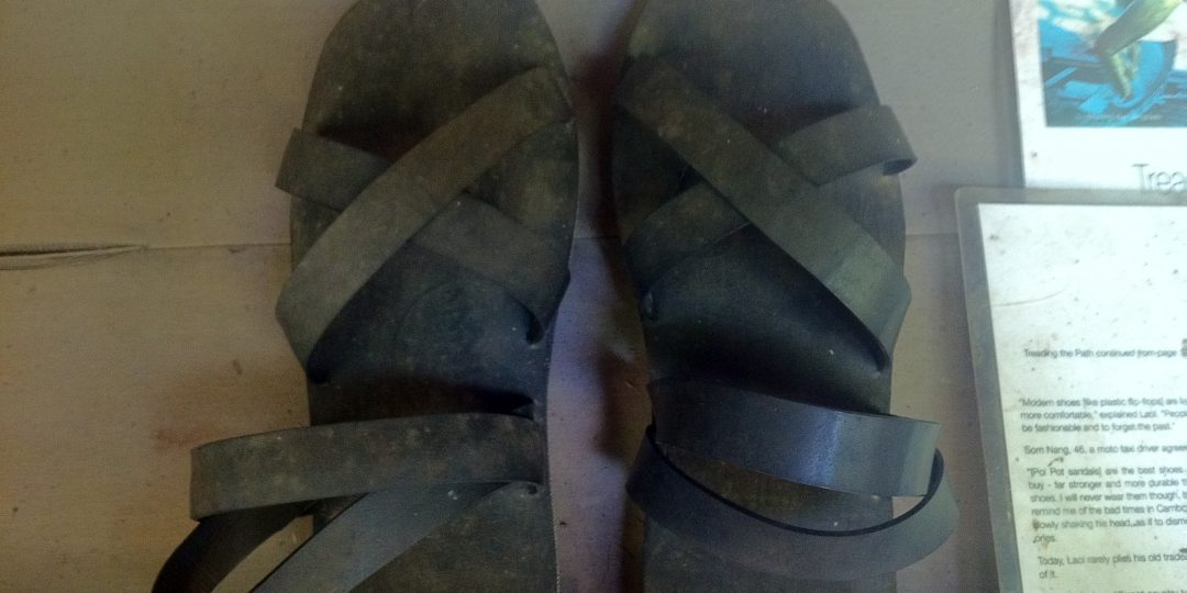 Pol Pot shoes.  So called, as they were the only shoes you could get during his reign.  They are made out of tyres - ONLY. Nothing else is used. Very practical as they are sturdy and good for the jungle, but people won't wear them now as they bring back too many bad memories.