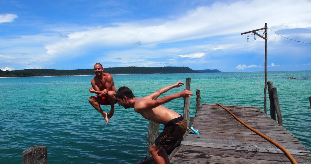 Seb & Lionel jumping of the pier with their 'Buddha' pose