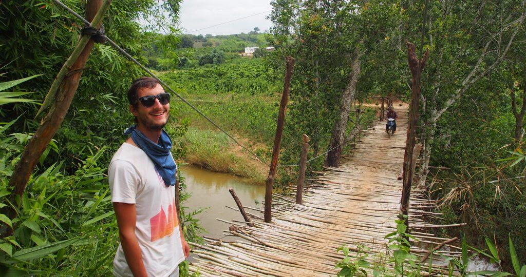A motorcyclist on the bamboo bridge