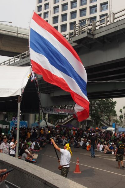 He waved this huge flag for ages outside Silom station. He must have incredible upper arm strength!