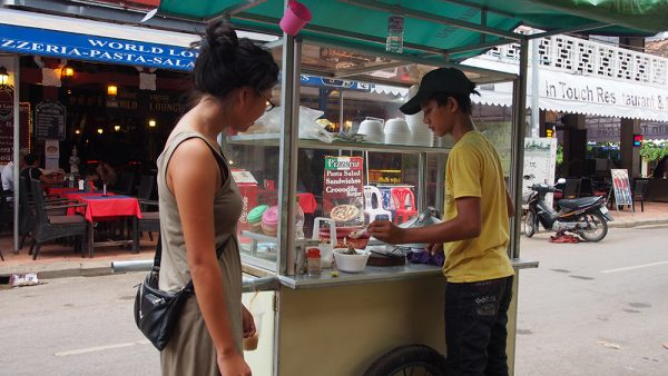 In Siem Reap, the first time we ordered street food. We were having a beer outside a restaurant when I watched the staff go outside and order some rice porridge off this boy. After 20 minutes of watching staff members from all of the Western restaurants come out, I knew I wanted it. If it's good enough for the locals, it's good enough for me. And my wallet!